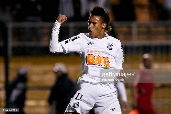 Neymar of Santos celebrates a scored goal against Once Caldas during a match as part of the Santander Libertadores Cup 2011 at Pacaembu stadium on...