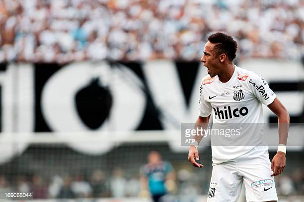 Neymar of Santos FC gestures during their 2013 Paulista championship final football match against Corinthians at Vila Belmiro stadium in Santos some...