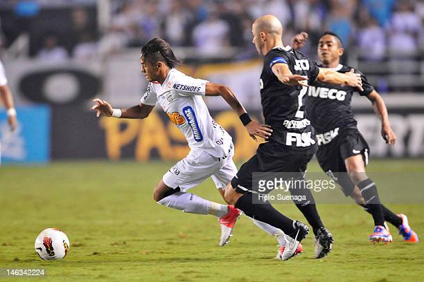 Neymar of Santos fights for the ball during a match between Santos and Corinthians as part of semifinal Santander Libertadores Cup 2012 at Vila...