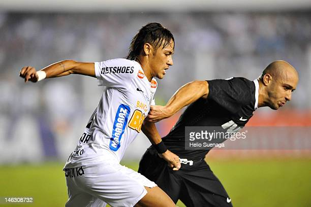 Neymar of Santos struggles for the ball with Alessandro of Corinthians during a match between Santos and Corinthians as part of the semifinal of Copa...