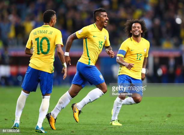Neymar Paulinho and Marcelo of Brazil celebrate a scored goal against Ecuador during a match between Brazil and Ecuador as part of 2018 FIFA World...