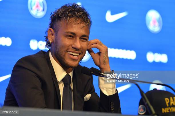 Neymar reacts during a press conference with Paris SaintGermain President Nasser AlKhelaifi on August 4 2017 in Paris France Neymar signed a 5 year...