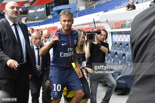 Neymar salutes the press after he posed with his new jersey after a press conference with Paris SaintGermain President Nasser AlKhelaifi on August 4...