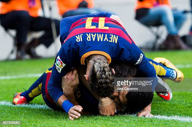 Neymar Santos Jr and Lionel Messi of FC Barcelona celebrate with their teammate Luis Suarez after he scored his team's second goal during the La Liga...