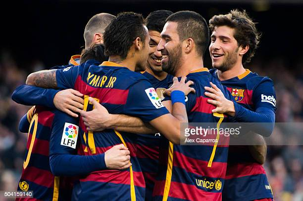 Neymar Santos Jr Luis Suarez Arda Turan and Sergi Roberto of FC Barcelona celebrate after their teammate Lionel Messi scored his team's third goal...