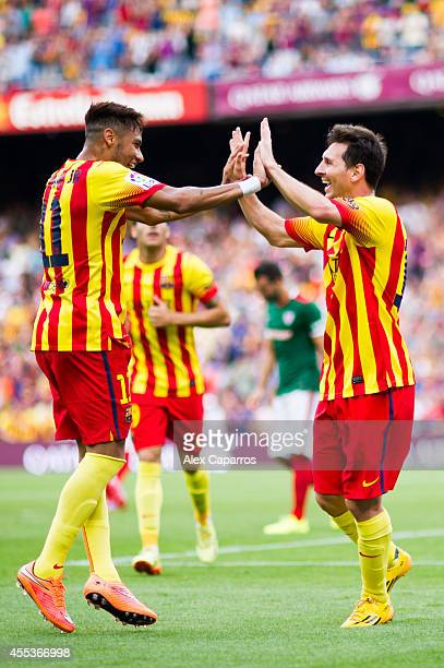 Neymar Santos Jr of FC Barcelona celebrates with his teammate Lionel Messi after scoring his second team's goal during the La Liga match between FC...