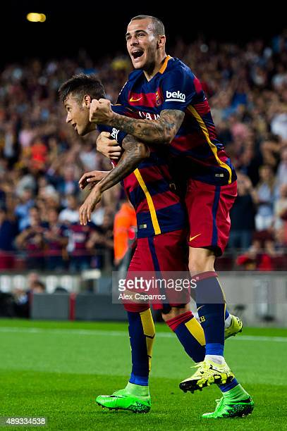 Neymar Santos Jr of FC Barcelona celebrates with his teammate Sandro Ramirez after scoring his team's second goal during the La Liga match between FC...