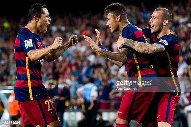 Neymar Santos Jr of FC Barcelona celebrates with his teammates Adriano Correia and Sandro Ramirez after scoring his team's second goal during the La...