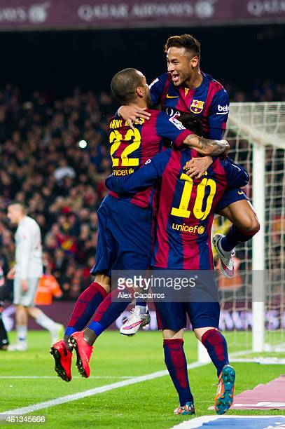 Neymar Santos Jr of FC Barcelona celebrates with his teammates Dani Alves and Lionel Messi after scoring the opening goal during the La Liga match...