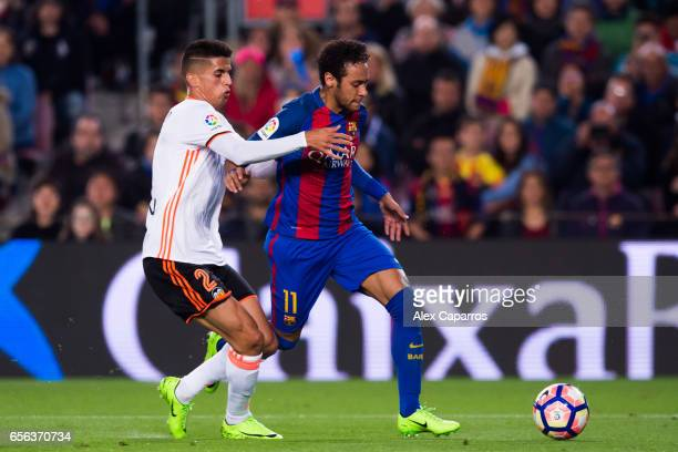 Neymar Santos Jr of FC Barcelona competes for the ball with Joao Cancelo of Valencia CF during the La Liga match between FC Barcelona and Valencia CF...