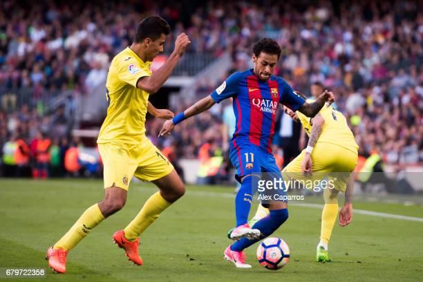 Neymar Santos Jr of FC Barcelona competes for the ball with Rodrigo Hernandez and Samu Castillejo of Villarreal CF during the La Liga match between...