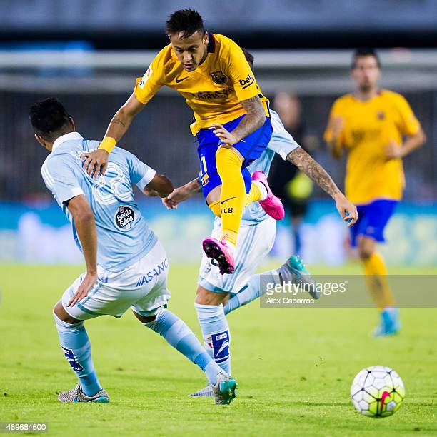 Neymar Santos Jr of FC Barcelona conducts the ball next to Gustavo Cabral during the La Liga match between Celta Vigo and FC Barcelona at Estadio...