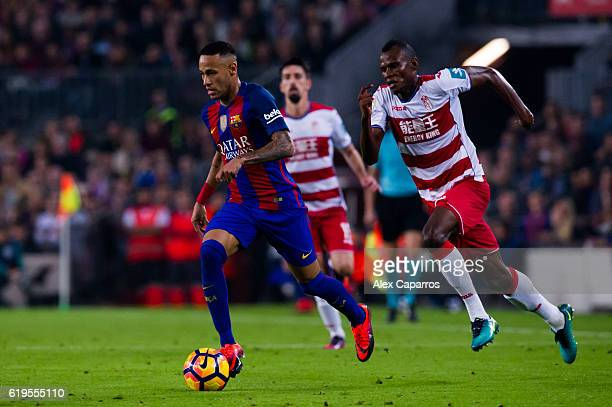 Neymar Santos Jr of FC Barcelona conducts the ball next to Uche Henry Agbo of Granada CF during the La Liga match between FC Barcelona and Granada CF...