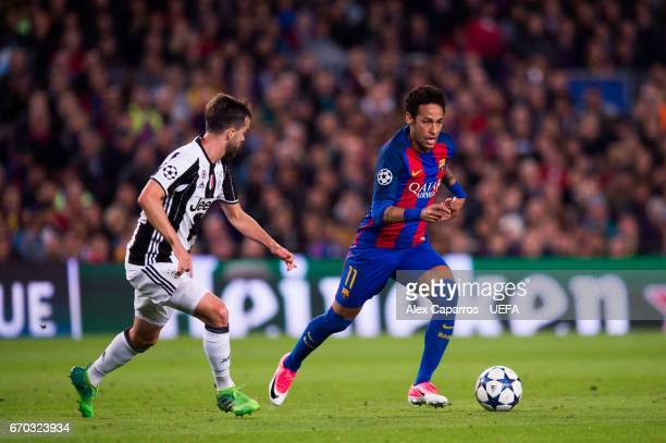Neymar Santos Jr of FC Barcelona conducts the ball past Miralem Pjanic of Juventus during the UEFA Champions League Quarter Final second leg match...