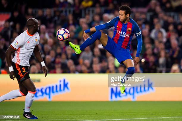 Neymar Santos Jr of FC Barcelona controls the ball next to Eliaquim Mangala of Valencia CF during the La Liga match between FC Barcelona and Valencia...