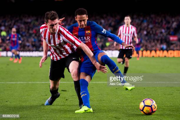 Neymar Santos Jr of FC Barcelona dribbles Aymeric Laporte of Athletic Club during the La Liga match between FC Barcelona and Athletic Club at Camp...