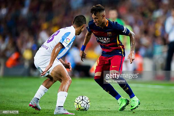 Neymar Santos Jr of FC Barcelona duels for the ball with Roberto Rosales of Malaga CF during the La Liga match between FC Barcelona and Malaga CF at...