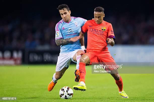 Neymar Santos Jr of FC Barcelona fights for the ball with Hugo Mallo of Celta Vigo during the La Liga match between Celta Vigo and FC Barcelona at...