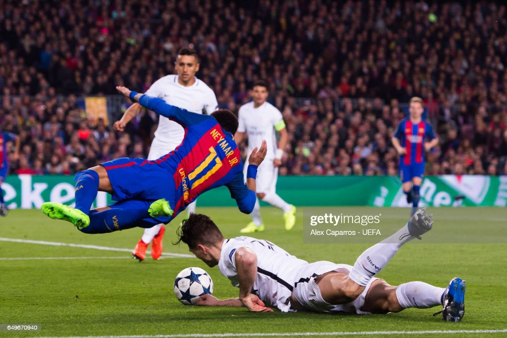 Neymar Santos Jr (L) of FC Barcelona is brought down by Thomas Meunier of Paris Saint-Germain inside the penalty area during the UEFA Champions League Round of 16 second leg match between FC Barcelona and Paris Saint-Germain at Camp Nou on March 8, 2017 in Barcelona, Spain.