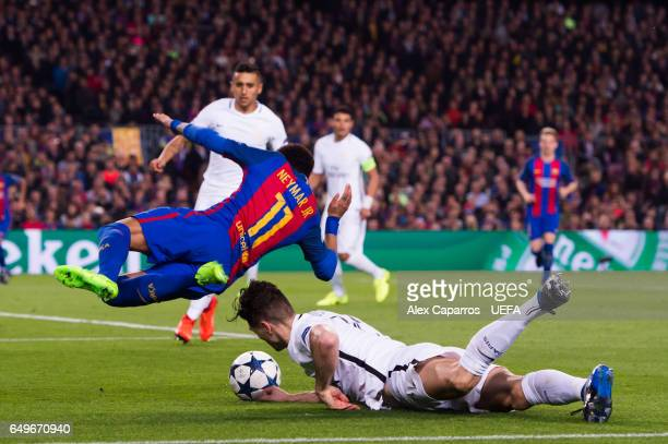 Neymar Santos Jr of FC Barcelona is brought down by Thomas Meunier of Paris SaintGermain inside the penalty area during the UEFA Champions League...