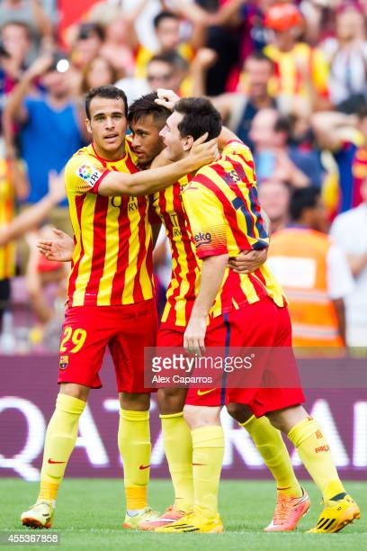 Neymar Santos Jr of FC Barcelona is congratulated by his teammates Sandro Ramirez and Lionel Messi after scoring the opening goal during the La Liga...