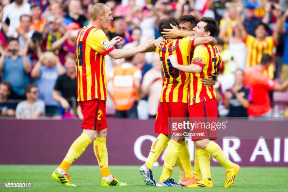 Neymar Santos Jr of FC Barcelona is congratulated by his teammates Jeremy Mathieu Jordi Alba and Lionel Messi after scoring the opening goal during...