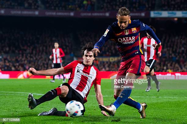 Neymar Santos Jr of FC Barcelona makes a pass with the opposition of Inigo Lekue of Athletic Club during the Copa del Rey Quarter Final Second Leg...
