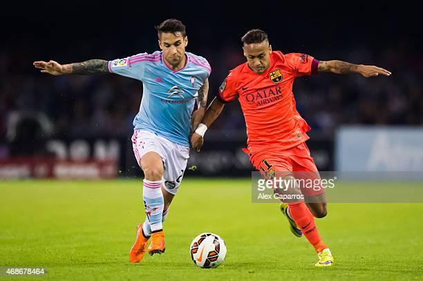 Neymar Santos Jr of FC Barcelona of FC Barcelona competes for the ball with Hugo Mallo of Celta Vigo during the La Liga match between Celta Vigo and...