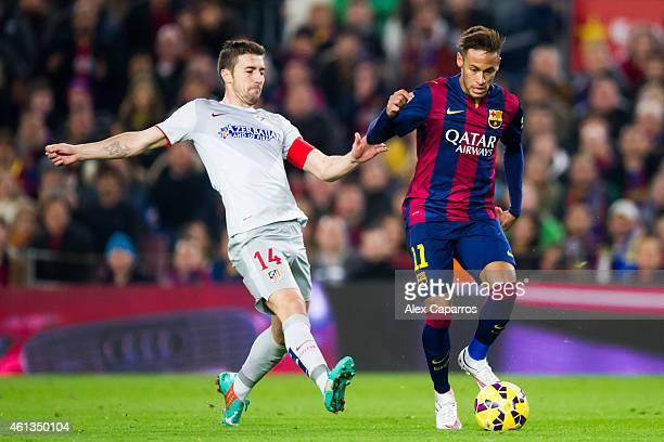 Neymar Santos Jr of FC Barcelona passes the ball next to Gabriel 'Gabi' Fernandez of Club Atletico de Madrid during the La Liga match between FC...