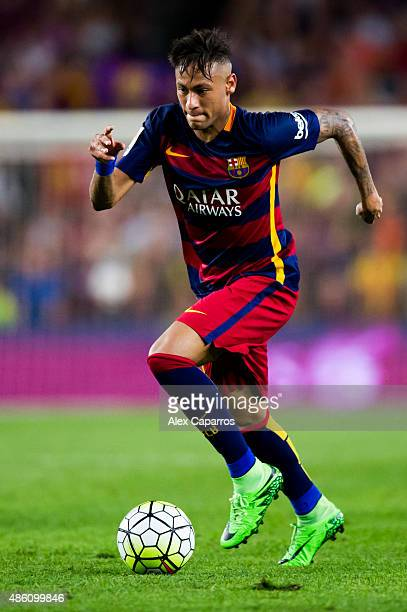 Neymar Santos Jr of FC Barcelona runs with the ball during the La Liga match between FC Barcelona and Malaga CF at Camp Nou on August 29 2015 in...