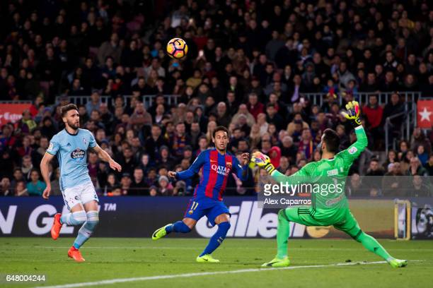 Neymar Santos Jr of FC Barcelona shoots the ball over goalkeeper Sergio Alvarez of RC Celta de Vigo and scores his team's second goal during the La...