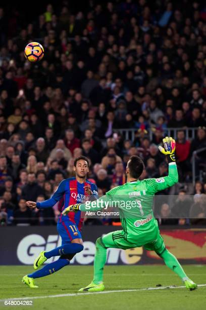 Neymar Santos Jr of FC Barcelona shoots the ball over goalkeeper Sergio Alvarez of RC Celta de Vigo and scores his team's second goal during the La...