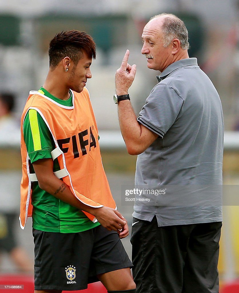 Neymar (L) shares a joke with manager Luiz Felipe Scolari during a Brazil training session ahead of their FIFA Confederations Cup 2013 Semi Final match against Uruguay on June 25, 2013 in Belo Horizonte, Brazil.