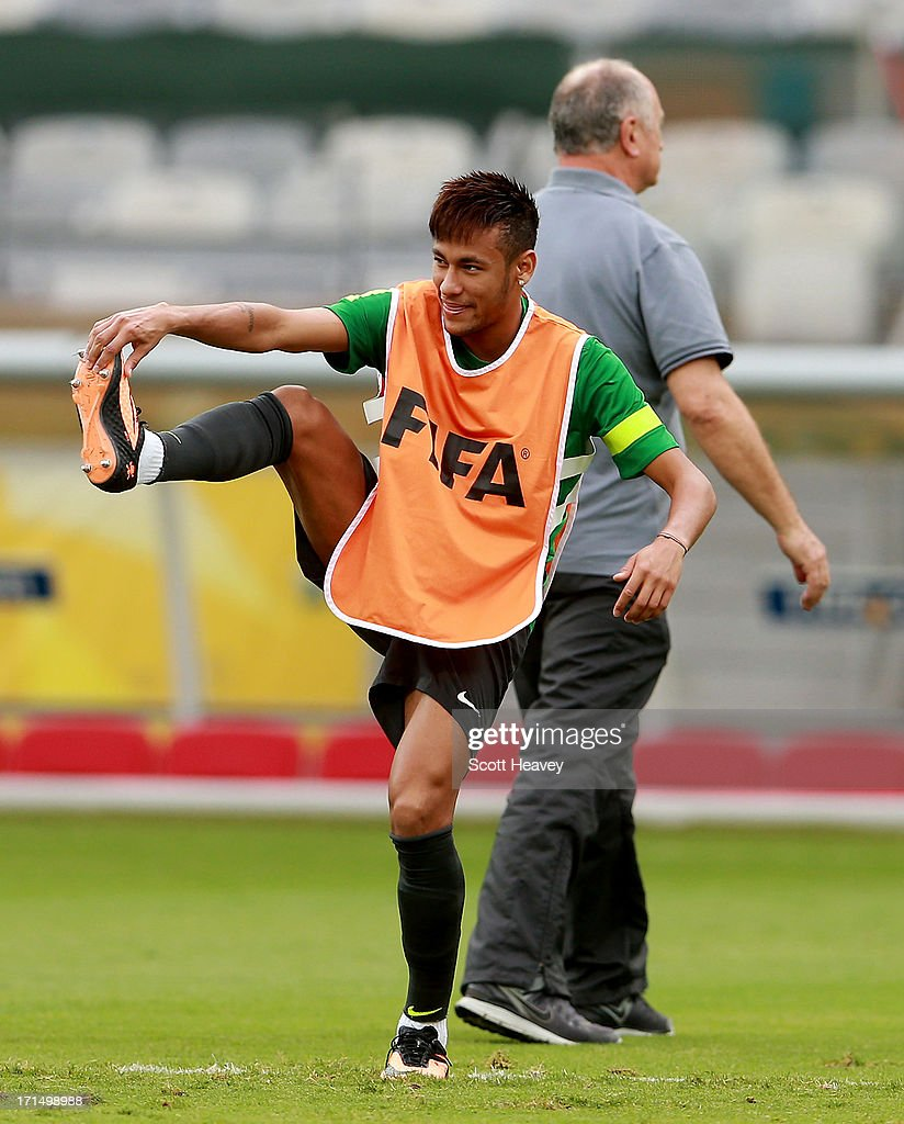 Neymar stretches out during a Brazil training session ahead of their FIFA Confederations Cup 2013 Semi Final match against Uruguay on June 25, 2013 in Belo Horizonte, Brazil.