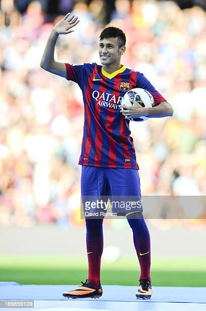 Neymar waves to the crowd during his official presentation as a new player of FC Barcelona at Camp Nou Stadium on June 3 2013 in Barcelona Spain