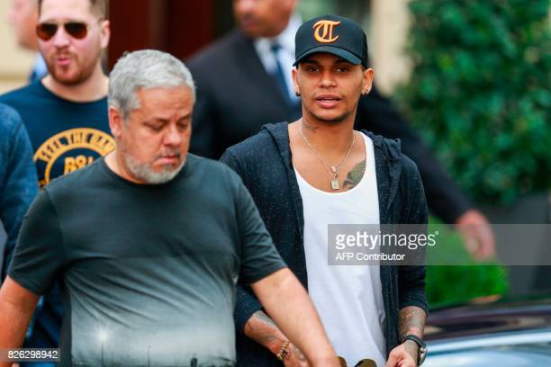 Neymar's close friend Cristian Guedes and the entourage of Brazilian footballer Neymar arrive on August 4 at the Royal Monceau hotel in Paris...