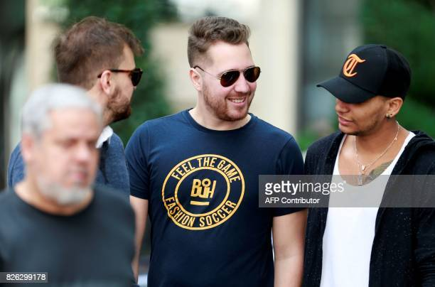 Neymar's close friend Cristian Guedes and the entourage of Brazilian footballer Neymar are pictured on August 4 2017 outside the Royal Monceau hotel...