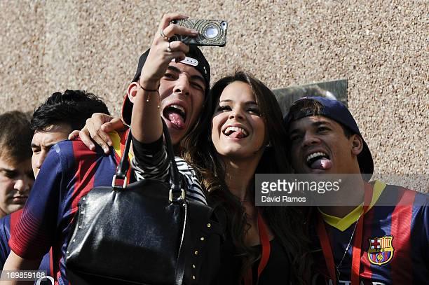 Neymar's girlfriend Bruna Marquezineshares a joke during her boyfriend's official presentation as a new player of the FC Barcelona at Camp Nou...