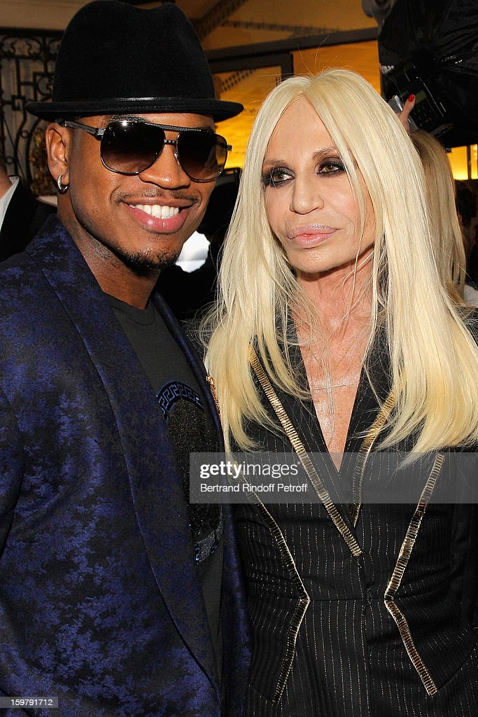 Ne-Yo (L) and Donatella Versace attend the Versace Spring/Summer 2013 Haute-Couture show as part of Paris Fashion Week at Le Centorial on January 20, 2013 in Paris, France.