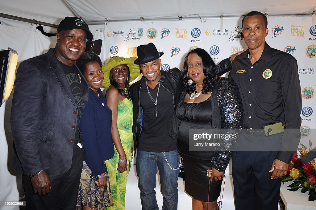 Ne-Yo (center) and Miami Gardens city council members pose backstage at the 8th Annual Jazz in the Gardens Day 2 at Sun Life Stadium presented by the City of Miami Gardens on March 17, 2013 in Miami Gardens, Florida.