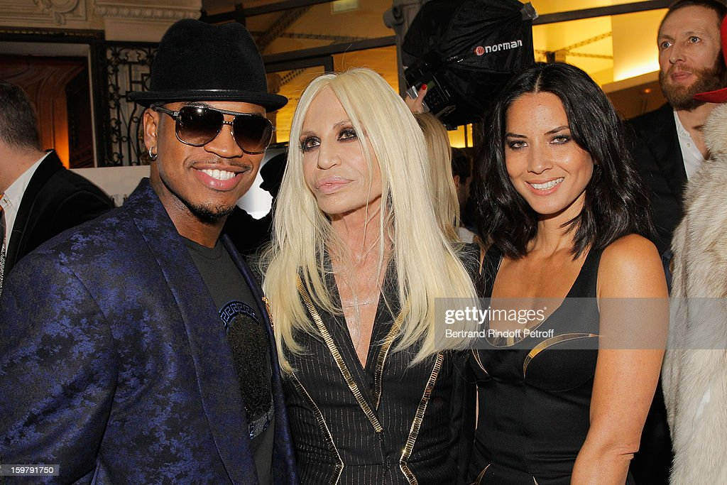 Ne-Yo, Donatella Versace and Olivia Munn attend the Versace Spring/Summer 2013 Haute-Couture show as part of Paris Fashion Week at Le Centorial on January 20, 2013 in Paris, France.