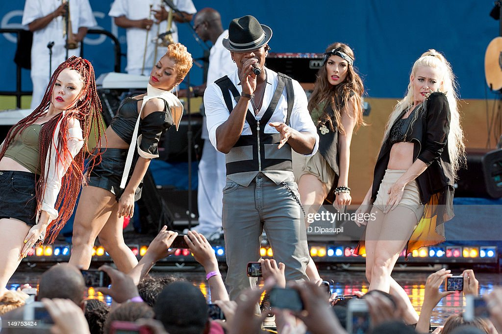 <a gi-track='captionPersonalityLinkClicked' href=/galleries/search?phrase=Ne-Yo&family=editorial&specificpeople=451543 ng-click='$event.stopPropagation()'>Ne-Yo</a> (C) performs on ABC's 'Good Morning America' at Rumsey Playfield, Central Park on August 3, 2012 in New York City.