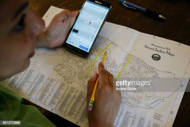 Nezzi Da Silva of the Watertown Teen Tree Stewardship program maps trees during a morning meeting in Watertown MA on Aug 2 2017 during the six week...