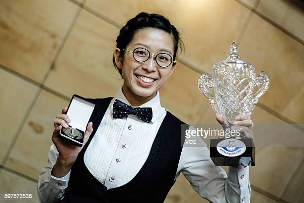 Ng OnYee of Hong Kong celebrates with the trophy after winning the final match against Reanne Evans of England on day 4 of the Paul Hunter Ladies...