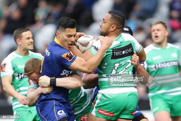 Ngani Laumape of Manawatu is tackled during the round three Mitre 10 Cup match between Otago and Manawatu on September 2 2017 in Dunedin New Zealand