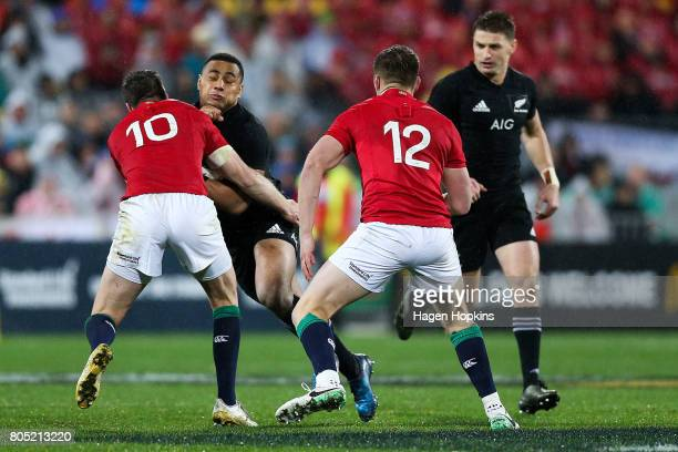 Ngani Laumape of New Zealand is tackled by Johnny Sexton of the Lions during the International Test match between the New Zealand All Blacks and the...