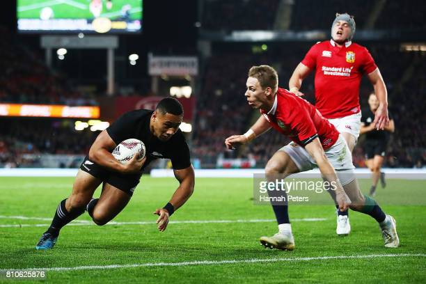 Ngani Laumape of the All Blacks dives over to score a try during the Test match between the New Zealand All Blacks and the British Irish Lions at...
