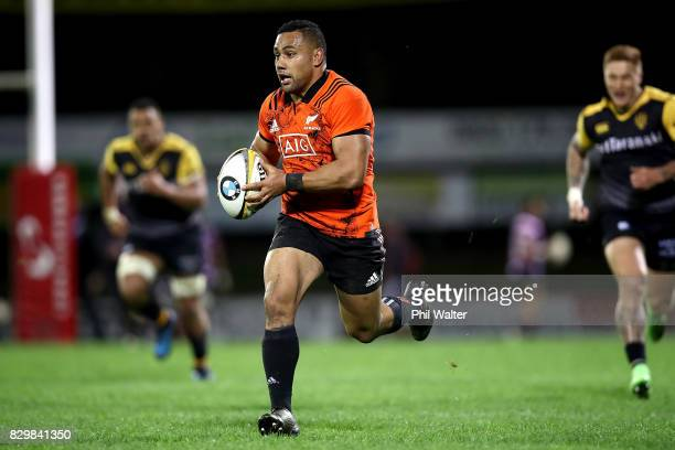 Ngani Laumape of the All Blacks makes a break during the Game of Three Halves between the All Blacks and Taranaki at ECOLight Stadium on August 11...