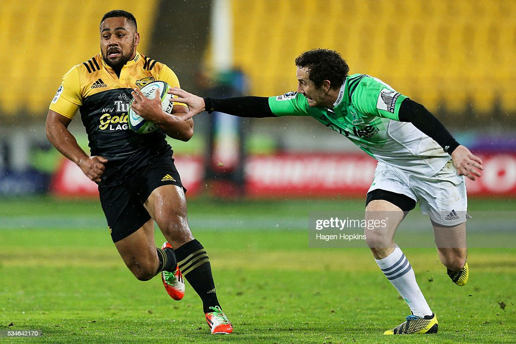 Ngani Laumape of the Hurricanes beats the tackle of Marty Banks of the Highlanders during the round 14 Super Rugby match between the Hurricanes and the Highlanders at Westpac Stadium on May 27, 2016 in Wellington, New Zealand.