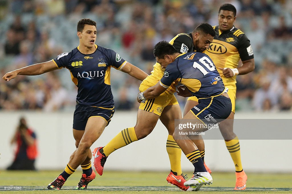 Ngani Laumape of the Hurricanes is tackled by Christian Lealiifano of the Brumbies during the round one Super Rugby match between the Brumbies and...